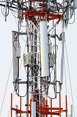 stock photo of wiretap  - Close up antenna repeater cell tower in city - JPG