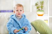 pic of teething baby  - Little baby boy with tooth brush in the living room - JPG