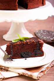 stock photo of torte  - Prune and chocolate torte slice - JPG