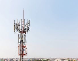 pic of wiretap  - Close up antenna repeater cell tower in city - JPG