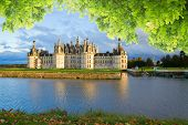 stock photo of chateau  - Chambord chateau at summer day, Pays-de-la-Loire, France ** Note: Visible grain at 100%, best at smaller sizes - JPG