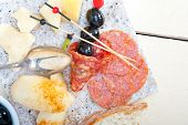 stock photo of salami  - cold cut assortment cheese salami and fresh pears served on a granite stone - JPG