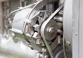 stock photo of lube  - Close up of transmission belt on car engine - JPG