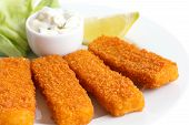 stock photo of tartar  - Golden fried fish fingers with lemon and tartar sauce - JPG