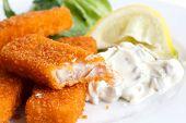 foto of tartar  - Half eaten fish fingers with lemon and tartar sauce - JPG