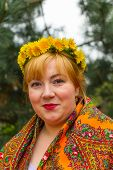image of flirty  - Cheeked Russian cheerful young woman in a wreath of fresh dandelion flirt flirty look - JPG