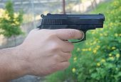 pic of pistols  - Detail of mans hand holding automatic pistol - JPG