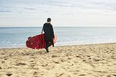 stock photo of paddling  - Man with stand up paddle board or sup on the beach - JPG