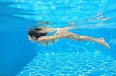 image of swimming  - Happy child swims in pool underwater - JPG