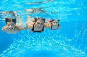 stock photo of swimming pool family  - Happy family swim underwater in pool and having fun - JPG