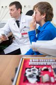 stock photo of infirmary  - Boy checks sight at the reception of an ophthalmologist in dark room - JPG