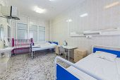 stock photo of ward  - hospital ward with beds and tables - JPG