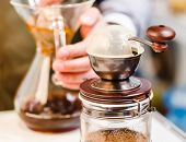 stock photo of brew  - Making brewed coffee from steaming filter drip style - JPG