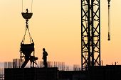 picture of concrete pouring  - Builders poured concrete in a new building at sunset - JPG