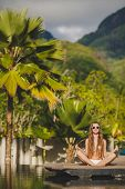pic of infinity pool  - Young beautiful brunette with long straight hair - JPG
