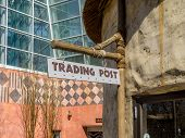 image of mud-hut  - Generic trading post sign with bamboo stand - JPG