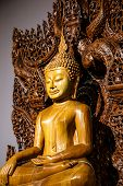 picture of carving  - Buddha carved wood at temple in Thailand - JPG