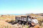 stock photo of truck farm  - Rusty Abandoned Truck on the Desert - JPG