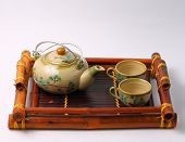 stock photo of serving tray  - Asian tea set served on a bamboo tray - JPG