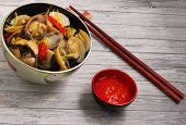 picture of clam  - herbal clam soup Vietnam style served on a wood table top - JPG