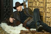 foto of wild west  - Bandit with gun in the wild west on carpet - JPG