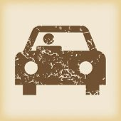foto of designated driver  - Grungy brown icon with image of car with driver - JPG