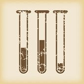 pic of tubes  - Grungy brown icon with image of three test tubes - JPG