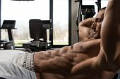 picture of abdominal muscle man  - Muscular Mature Man Exercising Abdominals On Exercise Ball In Modern Fitness Center - JPG