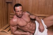 stock photo of sauna  - Good Looking And Attractive Mature Man With Muscular Body Relaxing In Sauna Hot - JPG