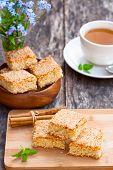 image of eat me  - homemade sesame cookies with cup of tea - JPG