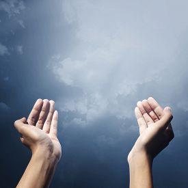 stock photo of muslim man  - Hand of muslim people with praying gesture praying facing sky - JPG