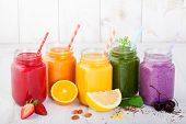 Smoothies, juices, beverages, drinks variety with fresh fruits and berries on a white wooden backgro poster