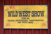 "image of wild west  - ""the real wild west show come see indians roughriders sharpshooters and much more..."" sign from the old time. - JPG"