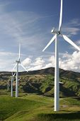 image of wind-power  - wind farm on top of green hills - JPG