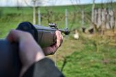 Постер, плакат: Hunter Shooting Wild Hens Hunter Aim His Target Jaeger Aim On His Hunting Ground Poacher Shootin