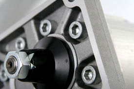 pic of plumper  - metal pump element with many bolts in gray and black colours