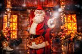 Santa Claus is a builder. House of Santa Claus. Portrait of Santa Claus with tools in his hands and  poster