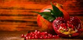 Juicy Pomegranate On Wooden Boards.cut Into Pieces Of Ripe Pomegranate. The Pomegranate Is Ripe. Rip poster
