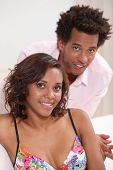stock photo of futon  - Couple relaxing at home - JPG