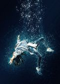 Woman is drowning under water. Horrible dream poster