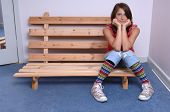 image of good-looker  - Teen Model sitting on bench smiling at Camera - JPG
