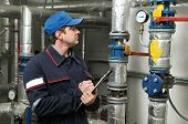 pic of pressure vessel  - maintenance repairman engineer of heating system equipment in a boiler house - JPG