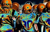 stock photo of football helmet  - three small boys in a football game - JPG
