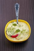 image of tadka  - Freshly prepared indian curry garnished with curry leaves and coriander leaves - JPG