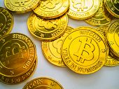 The Golden Coin With Bitcoin Symbol .physical Bit Coin. Digital Money. Cryptocurrency. On White Back poster