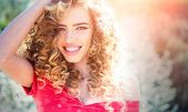 Spring Girl With Curly Hair Smiling. Beauty Hair Salon. Beauty Girl With Long And Shiny Curly Hair.  poster