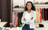 Successful Fashion Business. Smiling Black Designer Posing In Own Dressmaking Studio Or Boutique. Fr poster