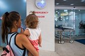 Mom And Child Come In In The Emergency Room At The Emergency Room In Hospital poster