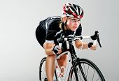 picture of bicycle gear  - Road bicycle woman riding her bike and concentrating on winning the cycle race - JPG