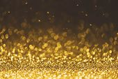 Gold Glitter Sparkle Lights Background. Defocused Glitter Abstract Twinkly Light And Shiny Stars. Ch poster